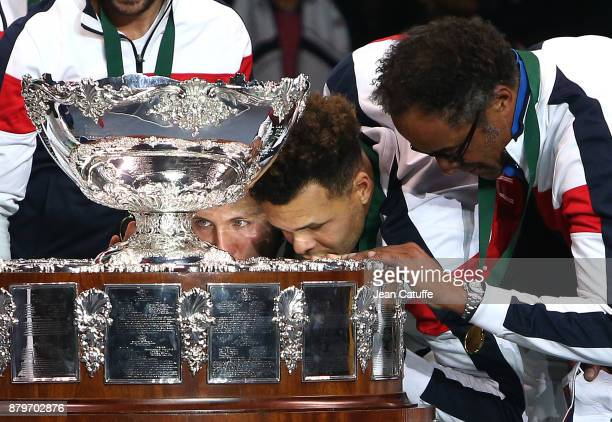 Lucas Pouille JoWilfried Tsonga captain of France Yannick Noah celebrate winning the Davis Cup during the trophy presentation on day 3 of the Davis...