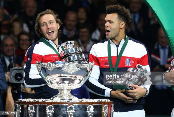 Lucas Pouille JoWilfried Tsonga of France celebrate winning the Davis Cup during the trophy presentation on day 3 of the Davis Cup World Group final...