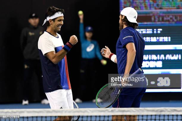 Lucas Pouille of France and Fernando Verdasco of Spain celebrate a point against Roberto Bautista Agut of Spain and Aljaz Bedene of Great Britain...