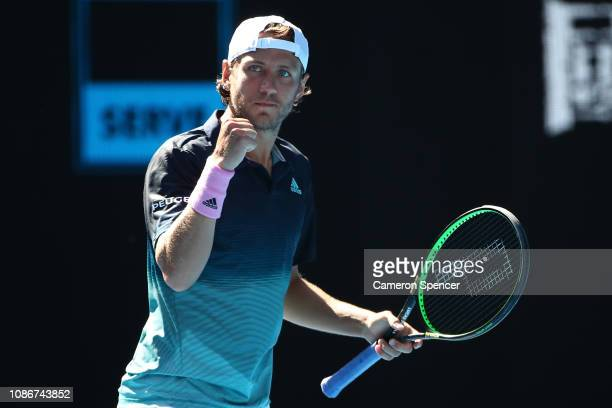 Lucas Pouille of France celebrates a point in his quarter final match against Milos Raonic of Canada during day 10 of the 2019 Australian Open at...