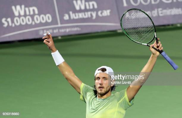 Lucas Pouille of France celebrates after defeating Filip Krajinovic of Serbia during their semifinal match in the 2018 ATP Dubai Duty Free Tennis...
