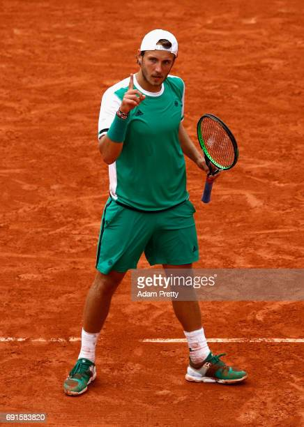 Lucas Pouille of France celebrates during mens singles third round match against Albert RamosVinolas of Spain on day six of the 2017 French Open at...