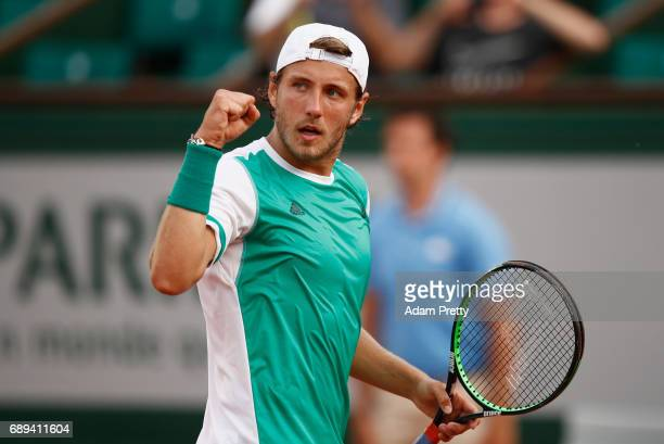 Lucas Pouille of France celebrates during the mens singles first round match against Julien Benneteau of France on day one of the 2017 French Open at...
