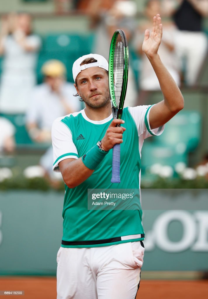 Lucas Pouille of France celebrates victory following victory over Julien Benneteau of France on day one of the 2017 French Open at Roland Garros on May 28, 2017 in Paris, France.