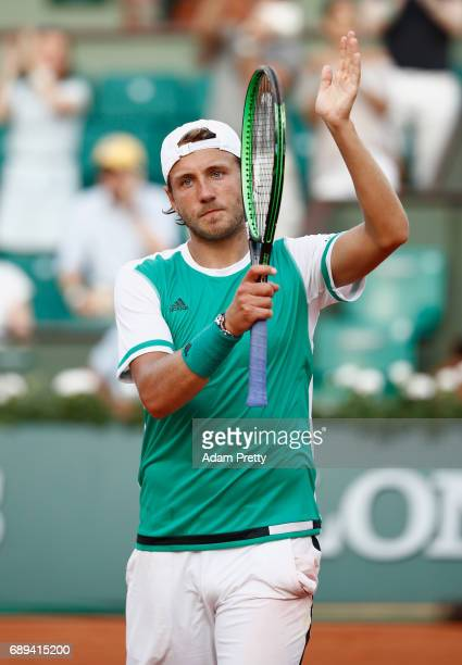 Lucas Pouille of France celebrates victory following victory over Julien Benneteau of France on day one of the 2017 French Open at Roland Garros on...