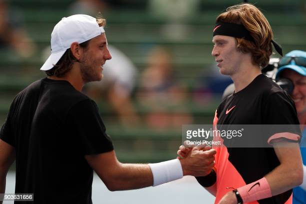 Lucas Pouille of France congratulates Andrey Rublev of Russia after being defeated by him during day three of the 2018 Kooyong Classic at Kooyong on...