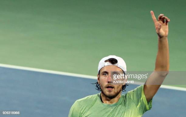 Lucas Pouille of France gestures after defeating Krajinovic of Serbia during their semifinal match in the 2018 ATP Dubai Duty Free Tennis...