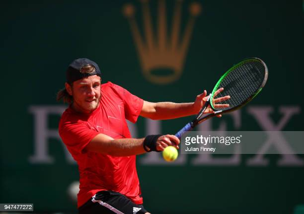 Lucas Pouille of France hits a backhand return during his Mens Singles match against Mischa Zverev of Germany at Monte-Carlo Sporting Club on April...