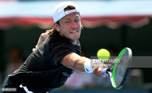 Lucas Pouille of France hits a backhand return to Andrey Rublev of Russia during their match at the Kooyong Classic tennis tournament in Melbourne on...