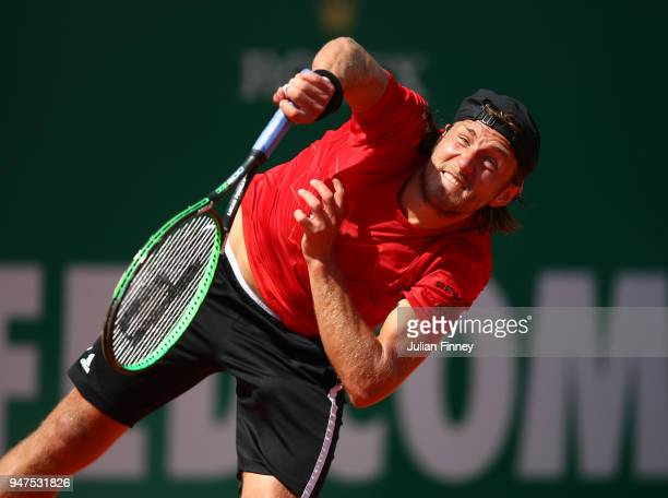 Lucas Pouille of France hits serves during his Mens Singles match against Mischa Zverev of Germany at MonteCarlo Sporting Club on April 17 2018 in...