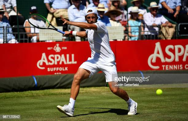 Lucas Pouille of France in action against Rafael Nadal of Spain during the Aspall Tennis Classic at Hurlingham on June 29 2018 in London England