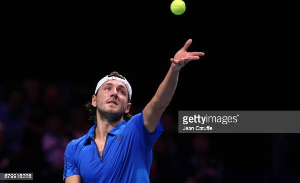 Lucas Pouille of France in action against Steve Darcis of Belgium during day 3 of the Davis Cup World Group final between France and Belgium at Stade...