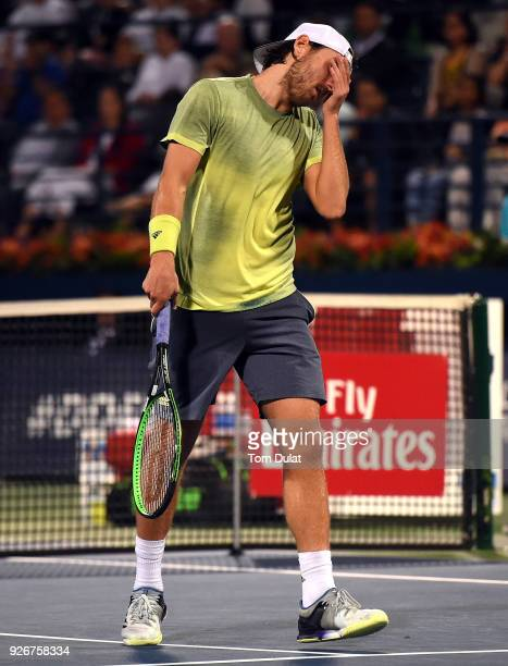 Lucas Pouille of France looks dejected during his final match against Roberto Bautista Agut of Spain on day six of the ATP Dubai Duty Free Tennis...