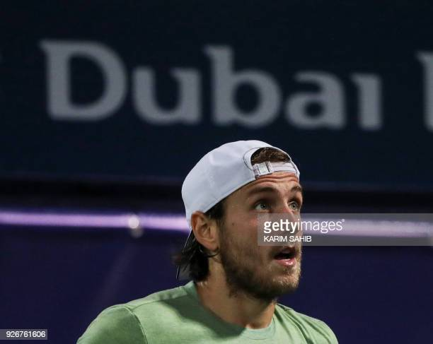 Lucas Pouille of France looks on during his 2018 ATP Dubai Duty Free Tennis Championships final match against Spain's Roberto Bautista Agut on March...