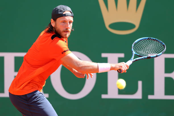 Lucas Pouille of France plays a back hand shot against Guido Pella of Argentina during the first round on day three of the Rolex Monte-Carlo Masters...