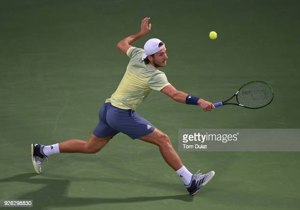 Lucas Pouille of France plays a backhand during his semi final match against Filip Krajinovic of Serbia on day five of the ATP Dubai Duty Free Tennis...