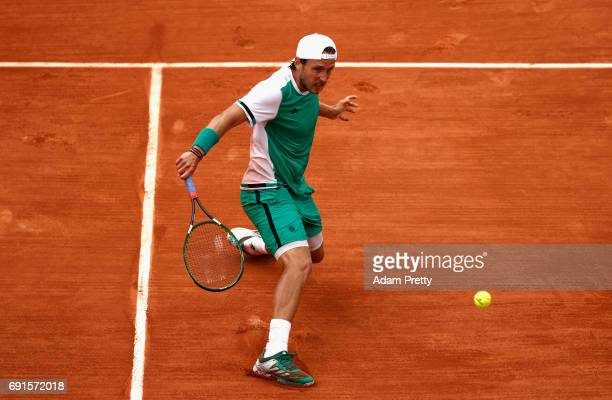 Lucas Pouille of France plays a backhand during mens singles third round match against Albert RamosVinolas of Spain on day six of the 2017 French...