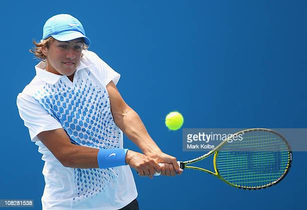 Lucas Pouille of France plays a backhand in his first round junior doubles match with partner Laurent Lokoli of France against Luis Patino of Mexico...