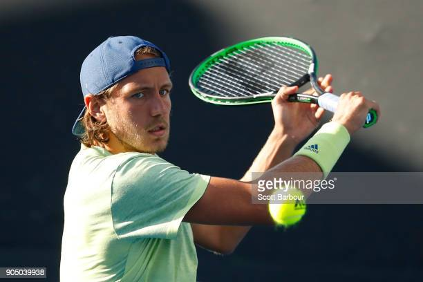 Lucas Pouille of France plays a backhand in his first round match against Ruben Bemelmans of Belgium on day one of the 2018 Australian Open at...