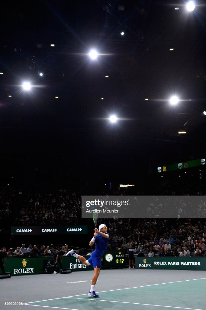 Lucas Pouille of France plays a backhand in the men's single first round match against Jack Sock of the United States of America during day four of the Rolex Paris Masters at Palais Omnisports de Bercy on November 2, 2017 in Paris, France.
