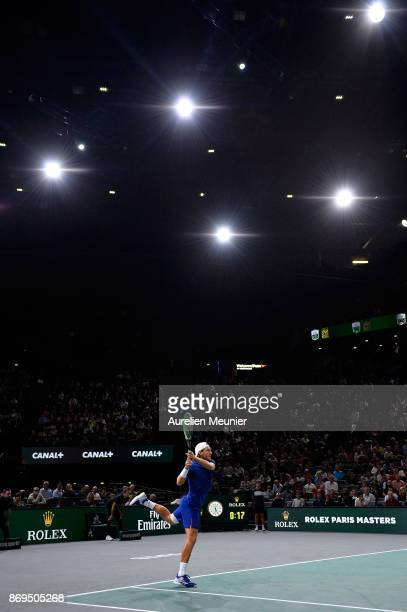 Lucas Pouille of France plays a backhand in the men's single first round match against Jack Sock of the United States of America during day four of...