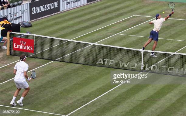 Lucas Pouille of France plays a backhand smash to Denis Istomin of Uzbekistan during day 5 of the Mercedes Cup at Tennisclub Weissenhof on June 15,...