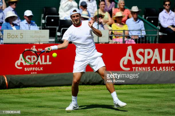 Lucas Pouille of France plays a forehand during his men's singles exhibition match against Rafael Nadal of Spain during the Aspall Tennis Classic at...