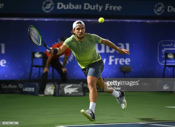 Lucas Pouille of France plays a forehand during his semi final match against Filip Krajinovic of Serbia on day five of the ATP Dubai Duty Free Tennis...