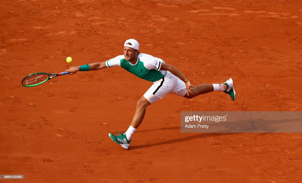 Lucas Pouille of France plays a forehand during the mens singles first round match against Julien Benneteau of France on day one of the 2017 French Open at Roland Garros on May 28, 2017 in Paris, France.