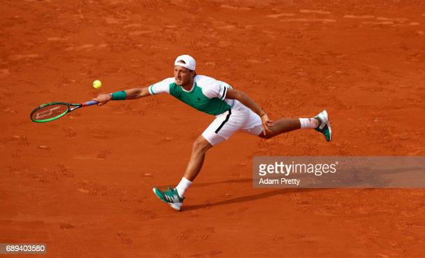 Lucas Pouille of France plays a forehand during the mens singles first round match against Julien Benneteau of France on day one of the 2017 French...