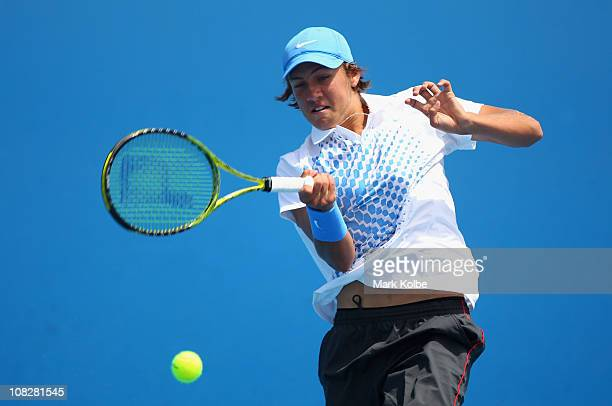 Lucas Pouille of France plays a forehand in his first round junior doubles match with partner Laurent Lokoli of France against Luis Patino of Mexico...