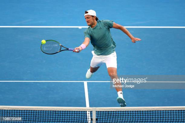 Lucas Pouille of France plays a forehand in his fourth round match against Borna Coric of Croatia during day eight of the 2019 Australian Open at...