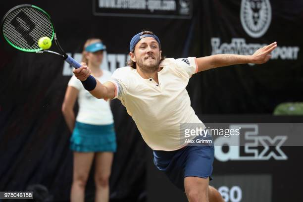 Lucas Pouille of France plays a forehand to Denis Istomin of Uzbekistan during day 5 of the Mercedes Cup at Tennisclub Weissenhof on June 15 2018 in...