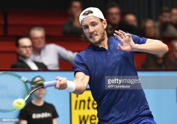 Lucas Pouille of France plays against Austria's Sebastian Ofner in their first round match of men's singles during the ATP tournament in Vienna...