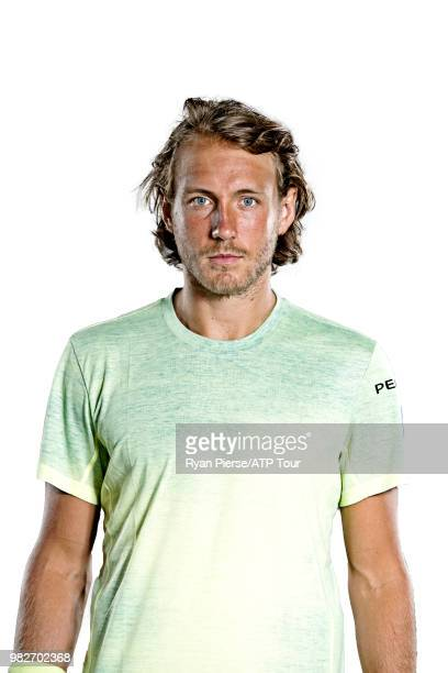 Lucas Pouille of France poses for portraits during the Australian Open at Melbourne Park on January 14 2018 in Melbourne Australia