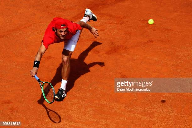 Lucas Pouille of France returns a forehand in his match against Andreas Seppi of Italy during day 3 of the Internazionali BNL d'Italia 2018 tennis at...