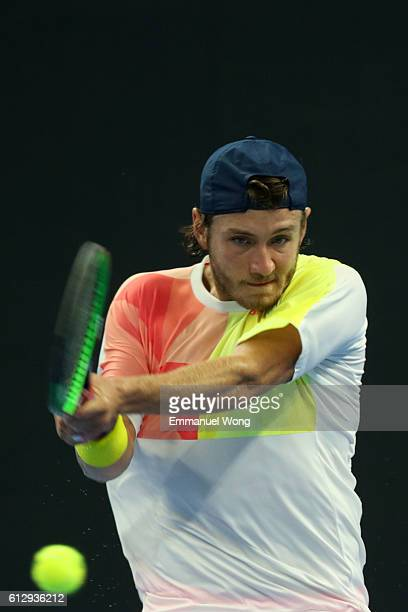 Lucas Pouille of France returns a shot against Grigor Dimitrov of Bulgaria during the Men's singles 2nd round match on day six of the 2016 China Open...
