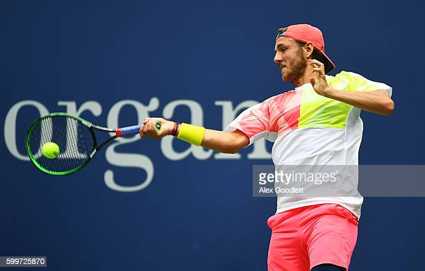 Lucas Pouille of France returns a shot to Gael Monfils of France during their Men's Singles Quarterfinal Match on Day Nine of the 2016 US Open at the...