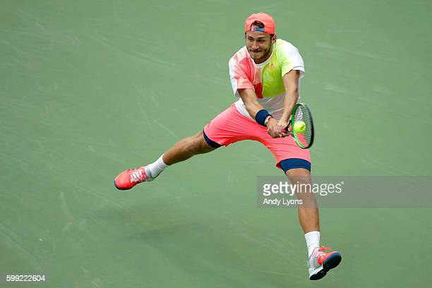 Lucas Pouille of France returns a shot to Rafael Nadal of Spain during his fourth round Men's Singles match on Day Seven of the 2016 US Open at the...
