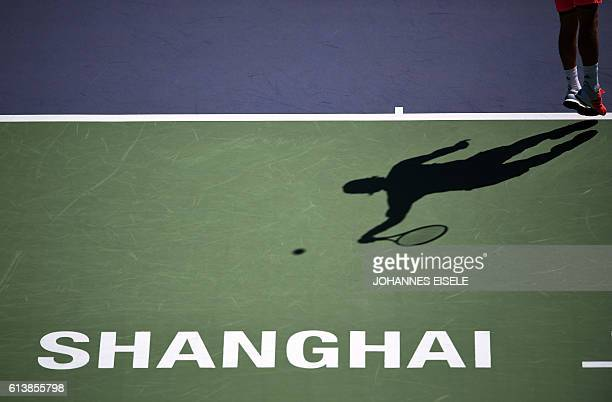 Lucas Pouille of France serves against Fernando Verdasco of Spain during their men's singles match at the Shanghai Masters tennis tournament on...