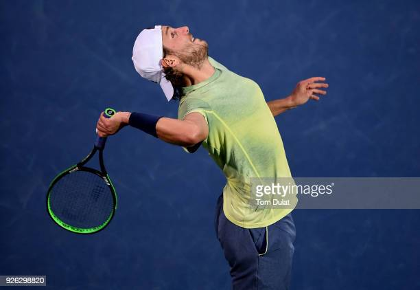 Lucas Pouille of France serves during his semi final match against Filip Krajinovic of Serbia on day five of the ATP Dubai Duty Free Tennis...