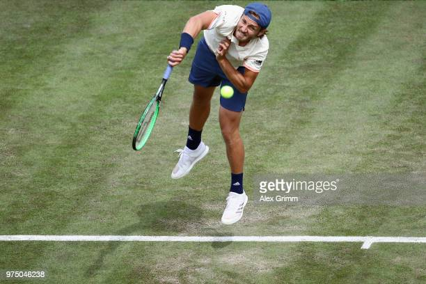 Lucas Pouille of France serves the ball to Denis Istomin of Uzbekistan during day 5 of the Mercedes Cup at Tennisclub Weissenhof on June 15 2018 in...