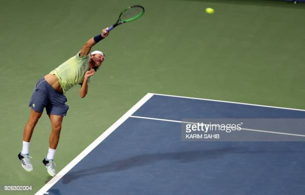 Lucas Pouille of France serves the ball to Filip Krajinovic of Serbia during their semifinal match in the 2018 ATP Dubai Duty Free Tennis...