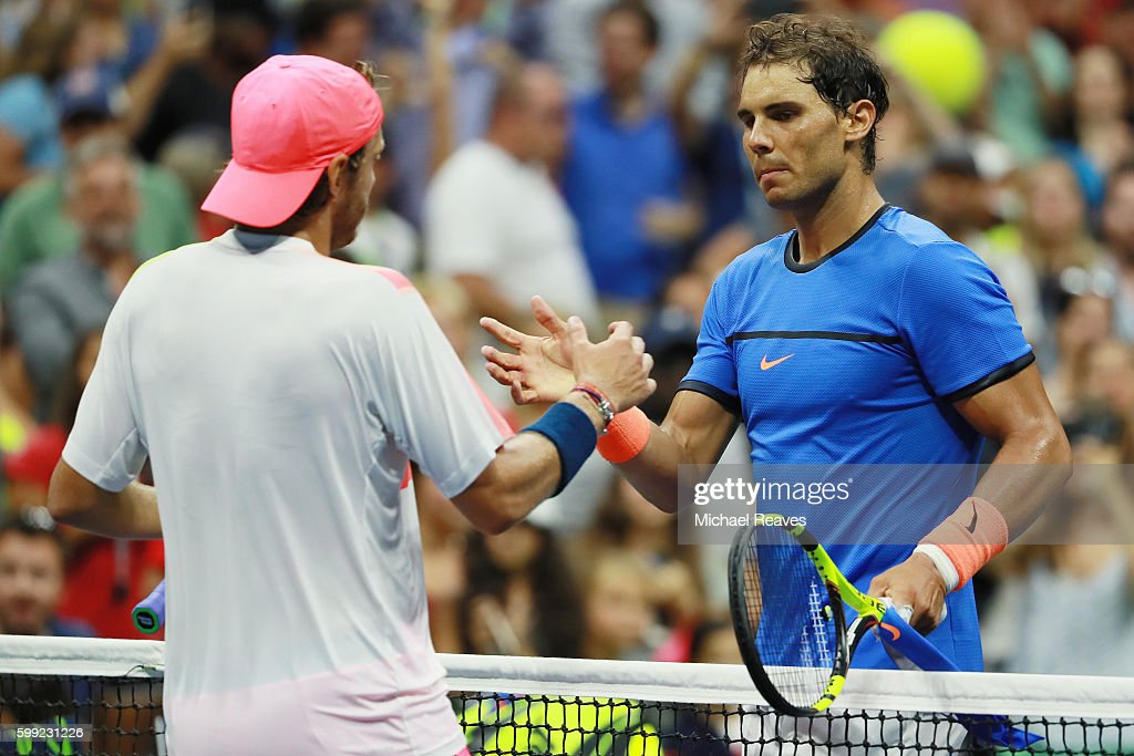 Lucas Pouille of France shakes hands after defeating Rafael Nadal of Spain during his fourth round Men's Singles match on Day Seven of the 2016 US Open at the USTA Billie Jean King National Tennis Center on September 4, 2016 in the Flushing neighborhood of the Queens borough of New York City.