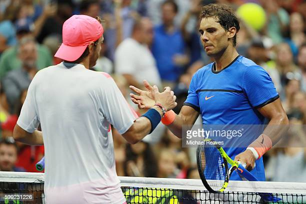 Lucas Pouille of France shakes hands after defeating Rafael Nadal of Spain during his fourth round Men's Singles match on Day Seven of the 2016 US...