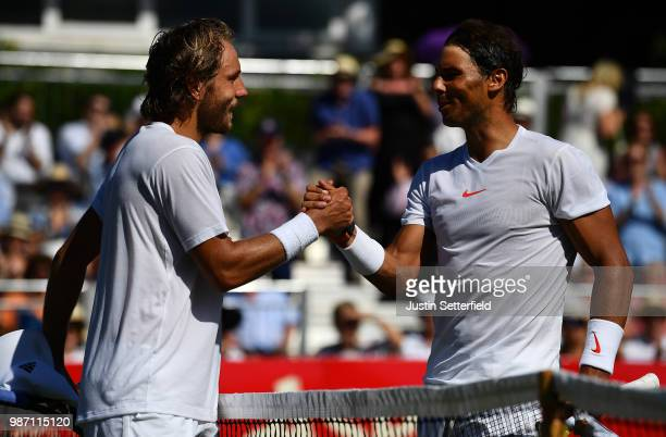 Lucas Pouille of France shakes hands at the net after beating Rafael Nadal of Spain 2 0 during the Aspall Tennis Classic at Hurlingham on June 29...