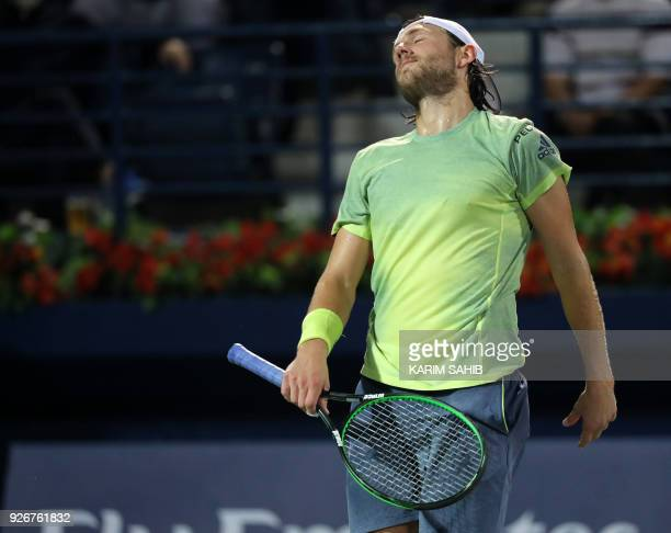 Lucas Pouille of France walks on the court during his 2018 ATP Dubai Duty Free Tennis Championships final match against Spain's Roberto Bautista Agut...