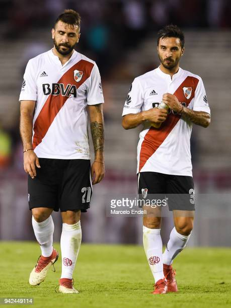 Lucas Pratto and Ignacio Scocco of River Plate leave the field after Copa CONMEBOL Libertadores match between River Plate and Independiente Santa Fe...