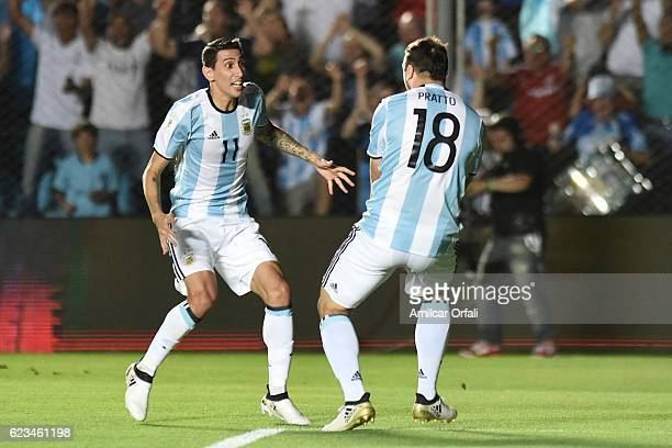 Lucas Pratto of Argentina celebrates with teammate Angel Di Maria after scoring the second goal of his team during a match between Argentina and...
