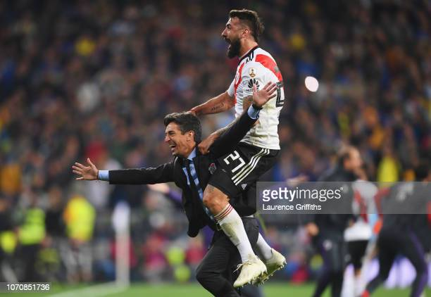 Lucas Pratto of River Plate and Hernan Bujan Assistant Manager of River Plate celebrate following their sides victory in the second leg of the final...